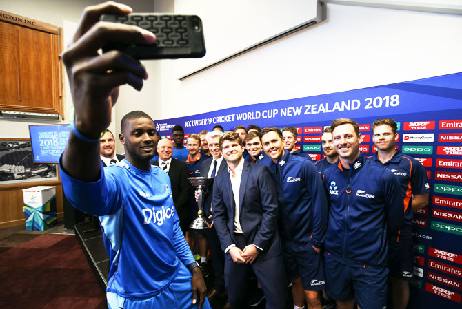 West Indies' Jason Holder takes a selfie during the official event launch of the ICC Under-19 Cricket World Cup in New Zealand at Basin Reserve in Wellington on Thursday