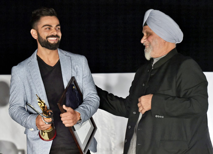 Legendary cricketer Bishan Singh Bedi felicitates Indian captain Virat Kohli at Delhi Captain Felicitation ceremony during the DDCAs 1st Annual Conclave 2017 at Ferozshah Kotla Stadium in New Delhi on Wednesday
