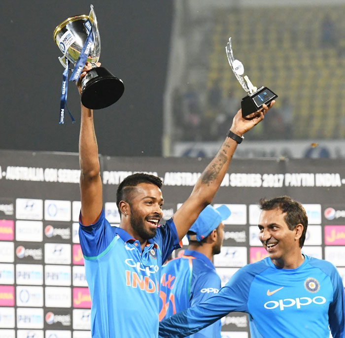 India's Hardik Pandya holds aloft his man-of-the-series trophy and the team trophy after the presentation ceremony in Nagpur on Sunday
