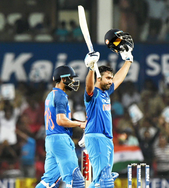 Rediff Cricket - Indian cricket - PHOTOS: Ton-up Rohit guides India to 7-wicket win over Aus in Nagpur