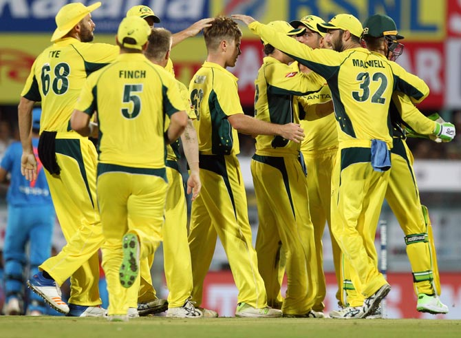 Australia's players celebrate after Adam Zampa dismisses Mahendra Singh Dhoni