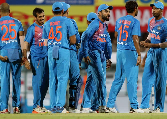 Skipper Virat Kohli leads India's celebrations after the fall of Aaron Finch's wicket