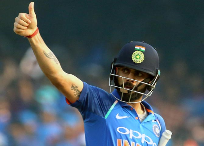 Rediff Sports - Cricket, Indian hockey, Tennis, Football, Chess, Golf - ICC Rankings: Kohli, Bumrah unmoved from top of ODI table