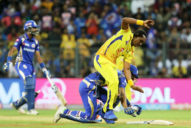 Hardik Panadya falls as he gets entangled with Dwayne Bravo while sliding to complete a run