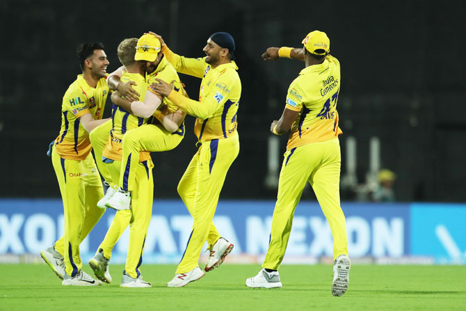 Chennai Super Kings players celebrate a wicket