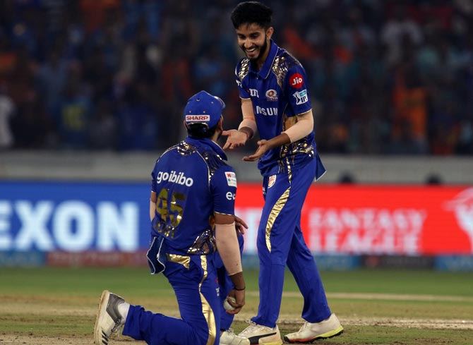 Mayank Markande celebrates with captain Rohti Sharma after taking the wicket