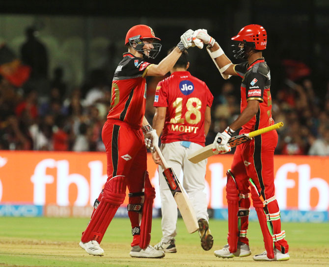 Royal Challengers Bangalore's Chris Woakes and Washington Sundar celebrate after the latter hit the winning runs