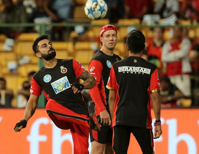 Virat Kohli, A B de Villiers and Yuzvendra Chahal play football ahead of an IPL game. Photograph: BCCI