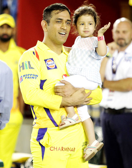Mahendra Singh Dhoni in a playful mood with his daughter Ziva