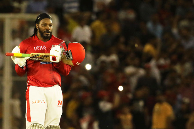 Chris Gayle gestures towards his family in the crowd as he celebrates his century