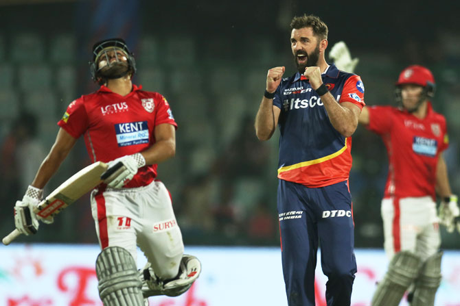 Delhi Daredevils' Liam Plunkett celebrates the wicket of Kings XI Punjab's Karun Nair