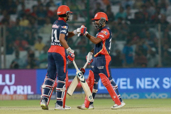 Rahul Tewatia and Shreyas Iyer celebrate their 50-run partnership