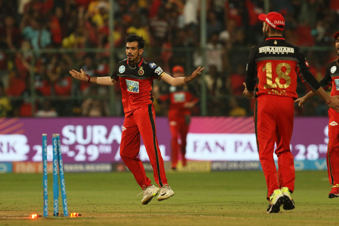 RCB's Yuzvendra Chahal celebrates the wicket of CSK's Sam Billings