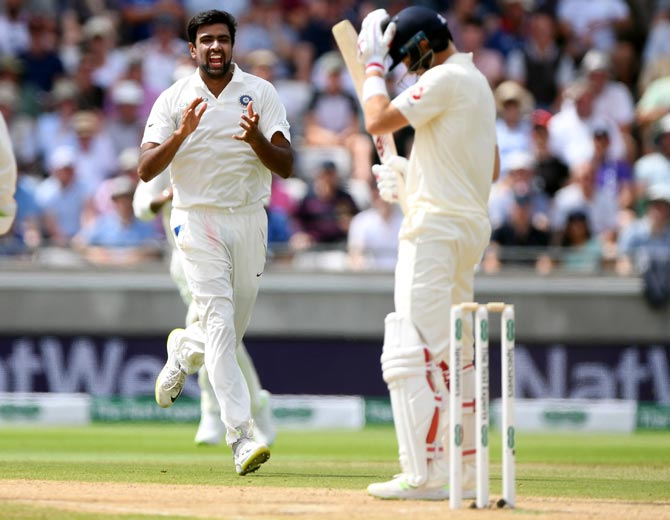England batsman Joe Root reacts as India bowler Ravi Ashwin celebrates his wicket during day 3 of the First Specsavers Test Match at Edgbaston on Friday