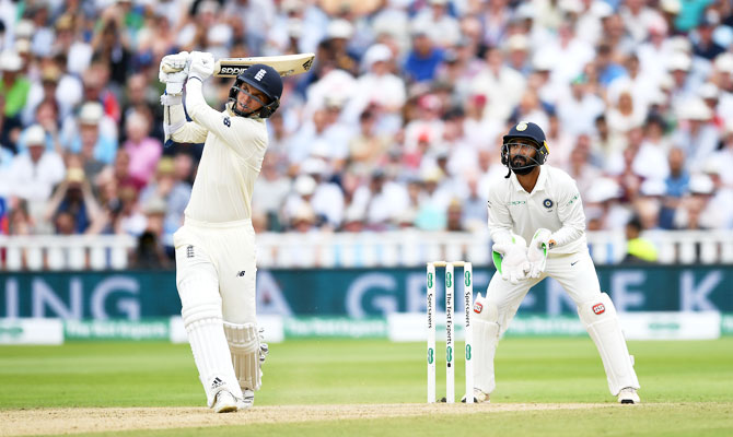England's Sam Curran hits a six to get to his half-century
