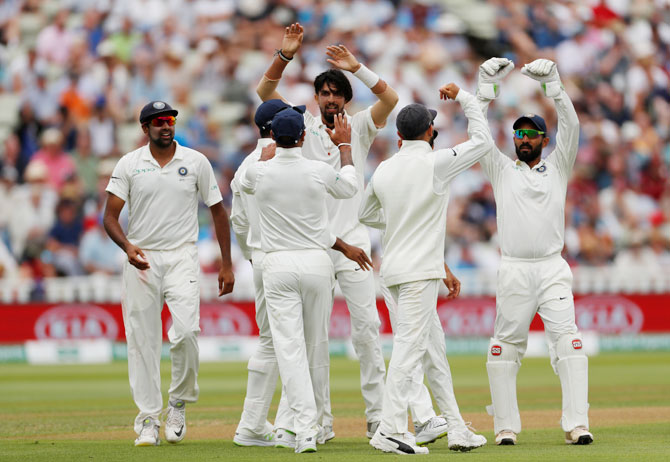 India's Ishant Sharma celebrates with teammates after taking the wicket of England's Ben Stokes