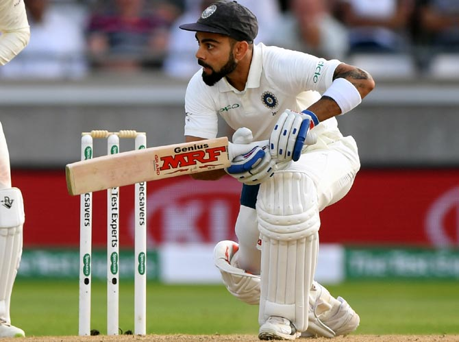 Rediff Sports - Cricket, Indian hockey, Tennis, Football, Chess, Golf - PHOTOS: Defiant Kohli keeps India afloat on Day 3
