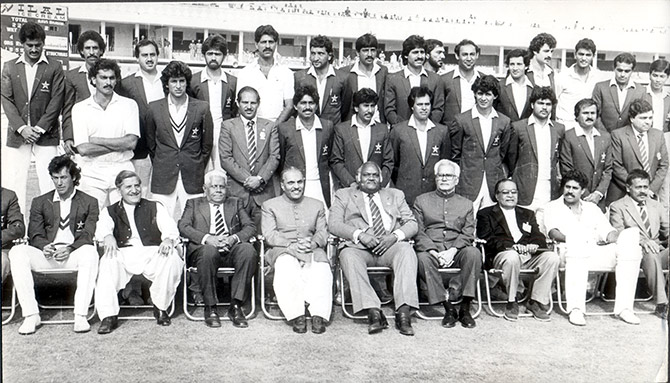 Imran Khan, left, with then Pakistan's military dictator General Zia-ul Haq, fourth from left, Indian and Pakistan cricketers, and cricket board officials from both nations at the Jaipur Test in 1987