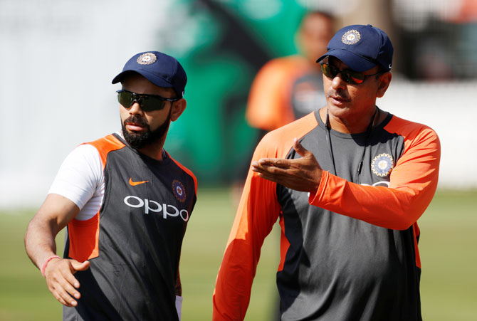 India head coach Ravi Shastri and Virat Kohli speak during a nets session on Tuesday