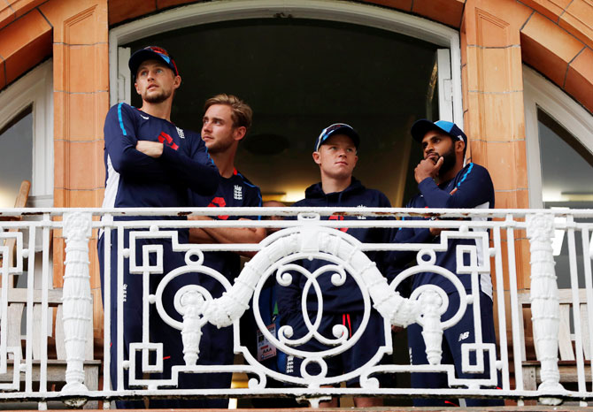England's Joe Root, Stuart Broad, Adil Rashid and Ollie Pope on the players balcony during a rain delay on Thursday