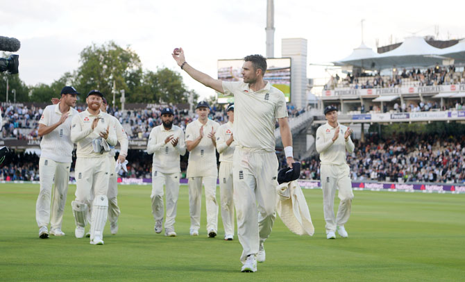 England's James Anderson acknowledges the crowd after taking a five wicket haul on Day 2 of the 2nd Test at Lord's Cricket Ground in London on Friday