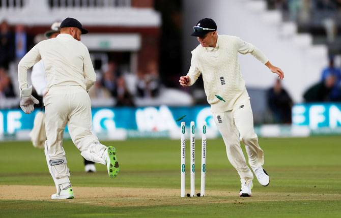 England's Ollie Pope removes the bail as he runs out India's Cheteshwar Pujara