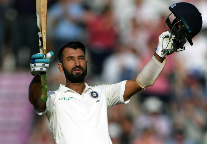 Rediff Sports - Cricket, Indian hockey, Tennis, Football, Chess, Golf - PHOTOS: Pujara's century keeps India afloat on Day 2