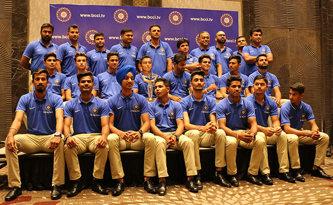 The victorious India Under-19 team and the support staff pose with the World Cup for a photo-op in Mumbai. Photograph: Satish Bodas/Rediff.com