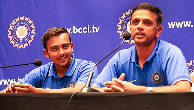 India Under-19 World Cup-winning Coach Rahul Dravid and Captain Prithvi Shaw at a media interaction on their arrival from New Zealand in Mumbai. Photograph: Satish Bodas/Rediff.com