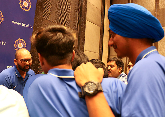 India Under-19 all-rounder Abhishek Sharma interrupts a media session to 'interview' bowling coach Paras Mhambrey