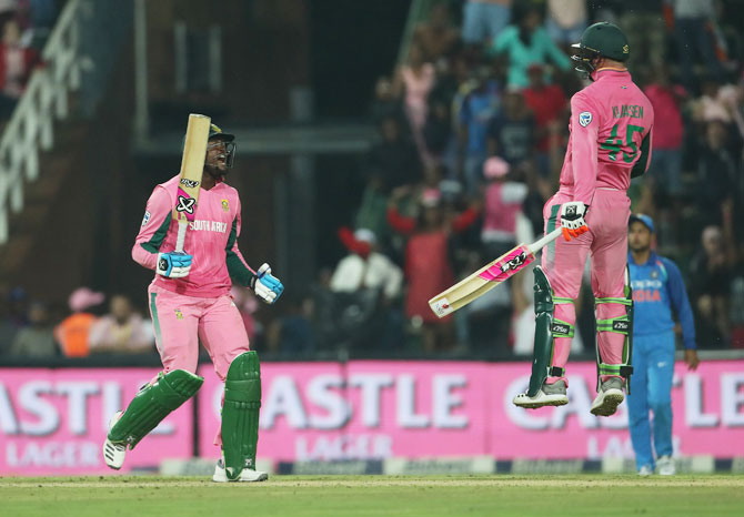 South Africa's Andile Phehlukwayo and Heinrich Klassen celebrate their win in the 4th ODI against India at the Wanderers Cricket Ground in Johannesburg on Saturday
