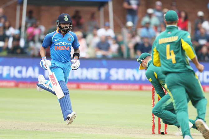 Virat Kohli watches as the bails are removed and he is run out