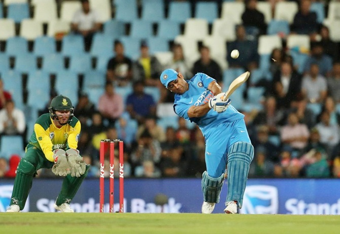 Mahendra Singh Dhoni hoists one over the boundary