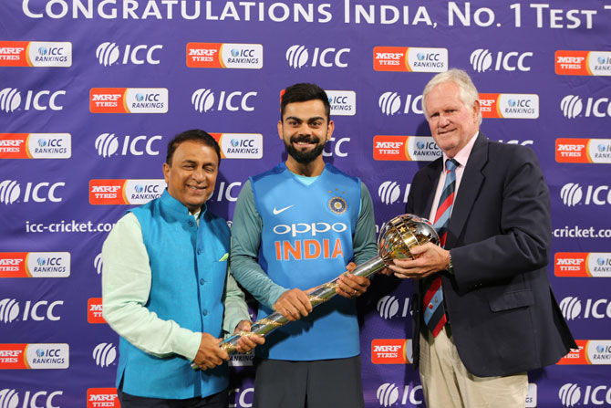 India captain Virat Kohli receives the Test mace from Sunil Gavaskar and Greame Pollock on Saturday