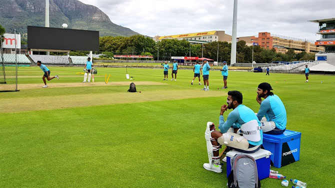 India openers Murali Vijay and KL Rahul watch on during a nets session at Newlands in Cape Town on Wednesday