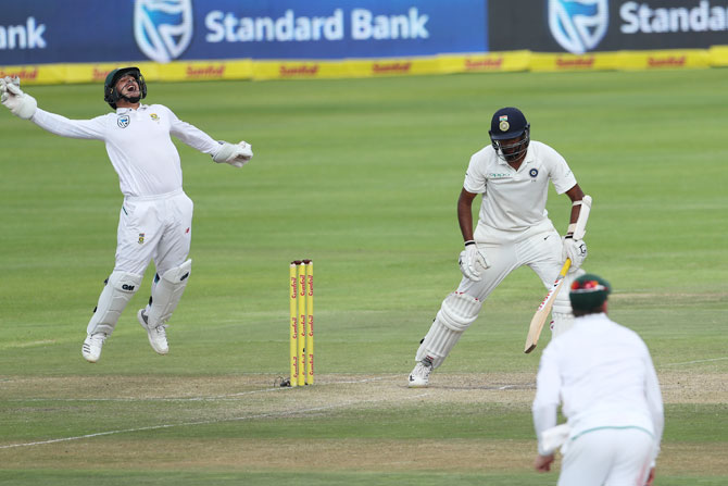 South Africa's Quinton de Kock takes the catch to dismiss India's Ravichandran Ashwin and effectively end India's fight on Day 4 of the first Test at the Newlands Cricket Ground in Cape Town on Monday
