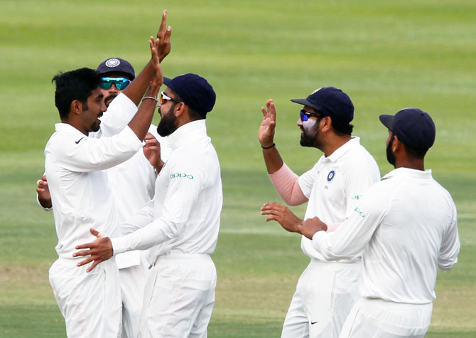 India's players celebrate with Jasprit Bumrah after a dismissal