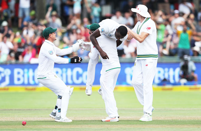 South Africa players celebrate with Kagiso Rabada after the wicket of Hardik Pandya