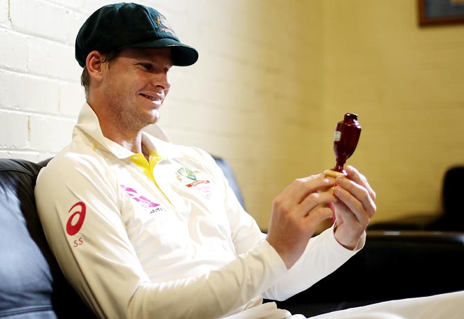 Australia captain Steve Smith spends a quiet moment with the Ashes Urn