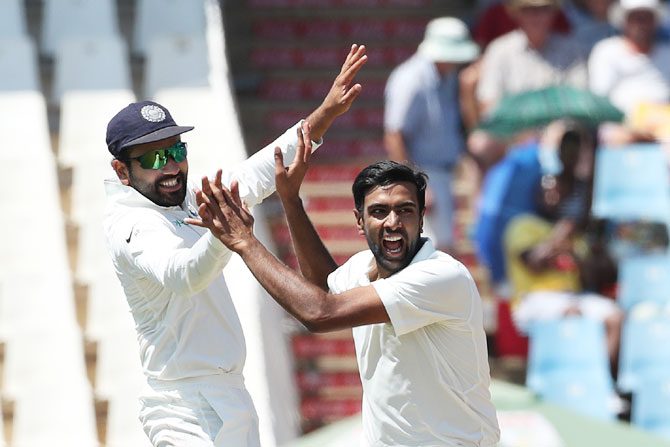 India's Ravichandran Ashwin celebrates with Rohit Sharma after picking the wicket of South Africa's Aiden Markram