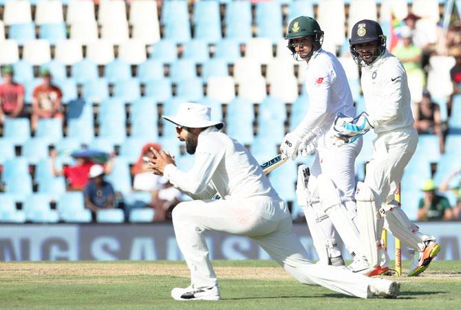 Virat Kohli takes a catch to dismiss Quinton de Kock