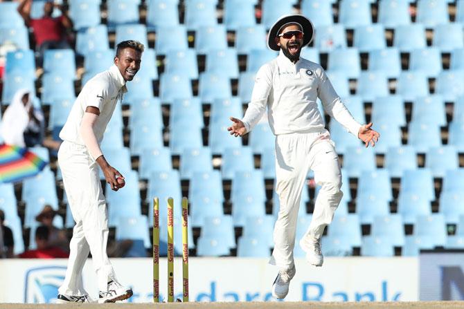 India captain Virat Kohli celebrates as Hardik Pandya knocks off the bails to run-out Vernon Philander
