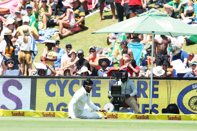 India'S KL Rahul slides as he fields on the boundary