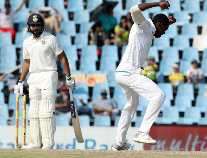 Kagiso Rabada celebrates after dismissing Rohit Sharma