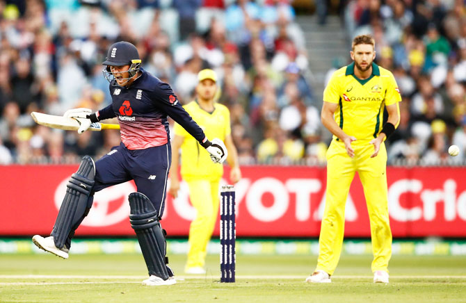 England's Jason Roy celebrates his century the first One Day International against Australia at Melbourne Cricket Ground in Melbourne on Sunday