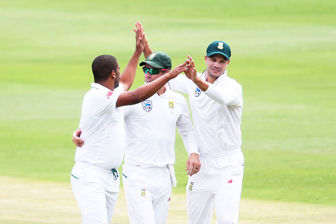 South Africa's Vernon Philander is congratulated by AB de Villiers and Aiden Markram after dismissing Lokesh Rahul