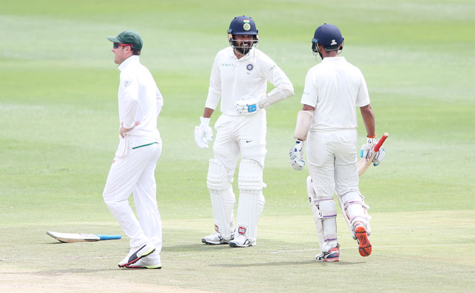 Murali Vijay reacts after being hit in the side by a Morne Morkel delivery