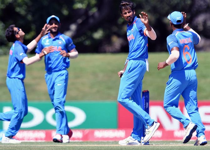 Ishan Porel, second from right, celebrates a wicket. Photograph: ICC/Twitter