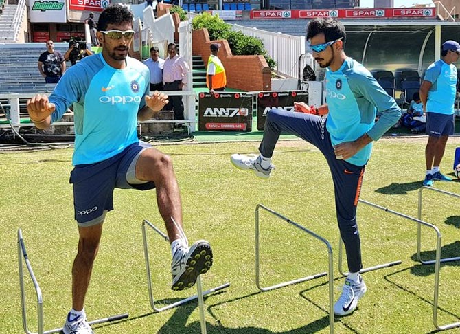 Jasprit Bumrah, left, with Yuzvendra Chahal during Team India's training session in Durban