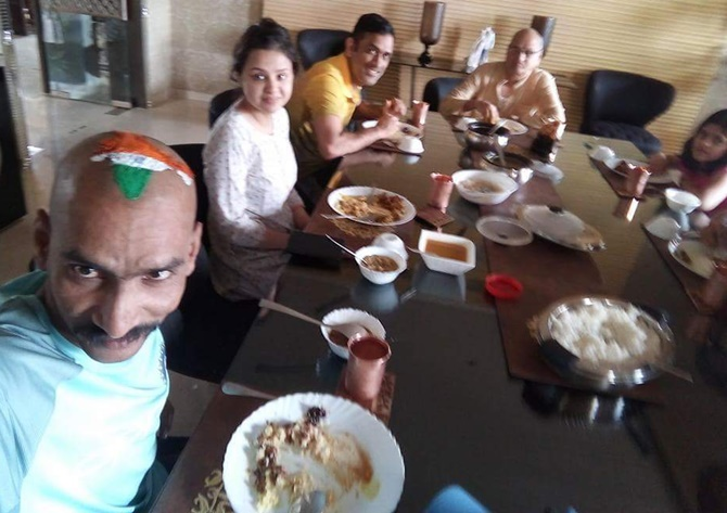 Rediff Cricket - Indian cricket - PIX: Dhoni hosts die-hard fan for special lunch